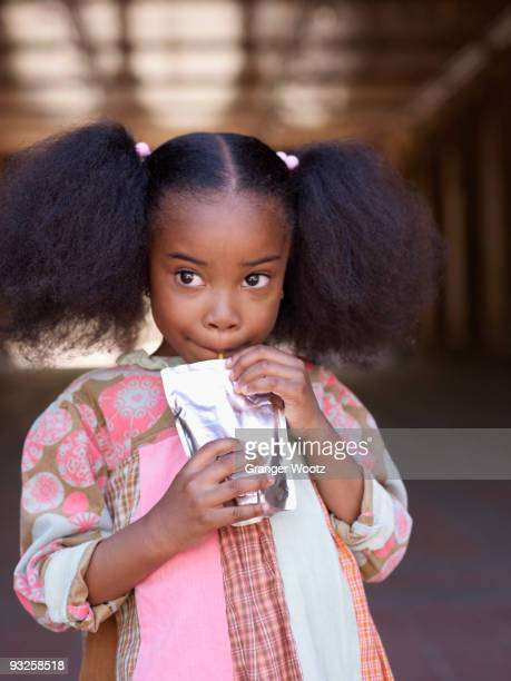 african girl drinking juice - juice carton stock photos and pictures