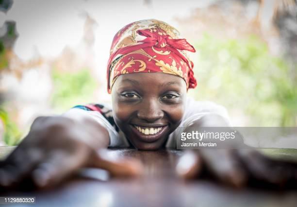 african girl enjoying in resort - afrika stock-fotos und bilder