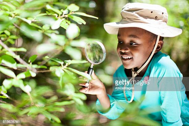 African girl exploring nature.