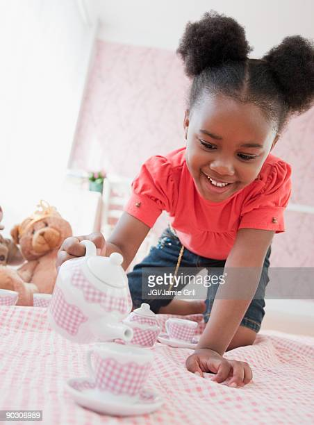 african girl having tea party - tea party stock pictures, royalty-free photos & images