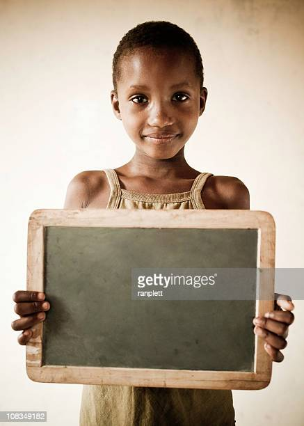 African Girl Holding a Blank Chalkboard