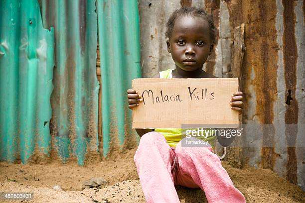 "african girl holding sign with ""malaria kills"" written on it - malaria parasite stock pictures, royalty-free photos & images"