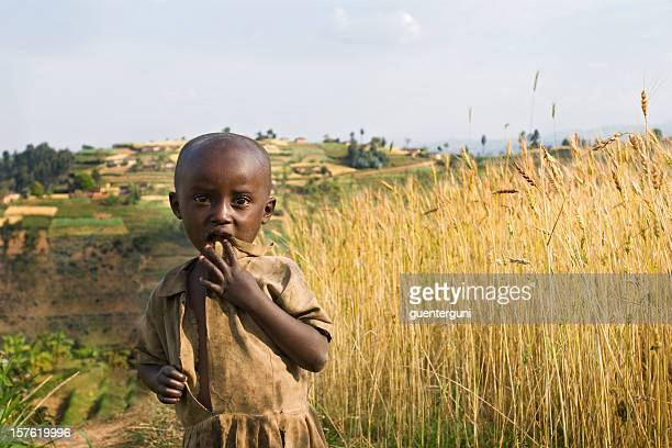 african girl in the fields - burundi east africa stock pictures, royalty-free photos & images