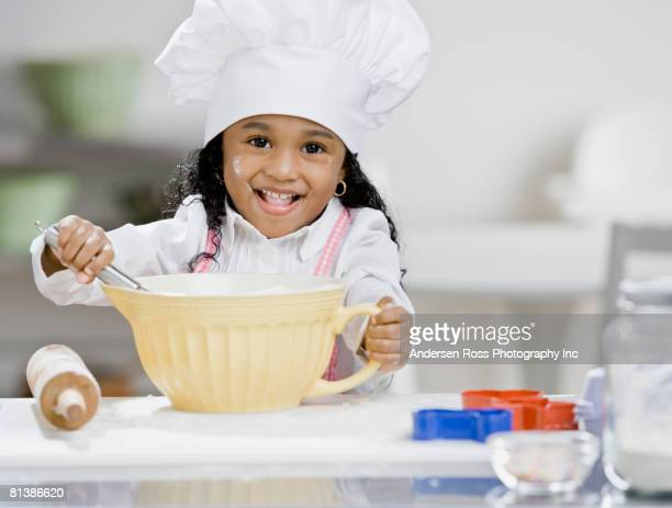 African girl mixing batter