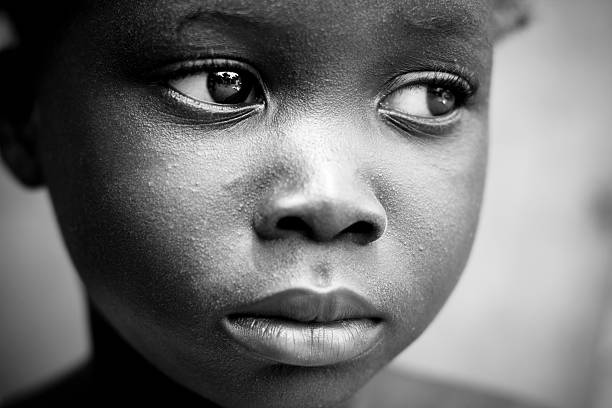 Black and white pensive child sad little girl african girl