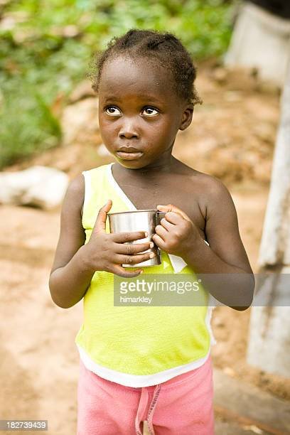 African girl sad and alone outside