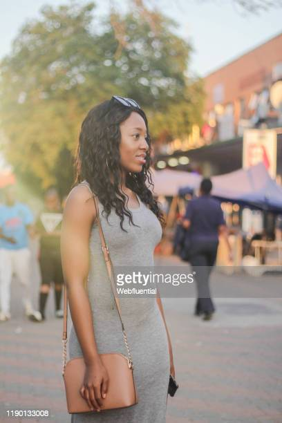 african girl standing in a market - webfluential stock pictures, royalty-free photos & images