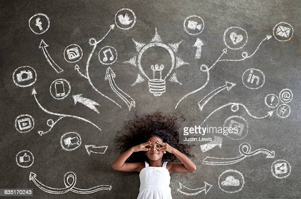 African Girl Surrounded by Chalk Tech Symbols
