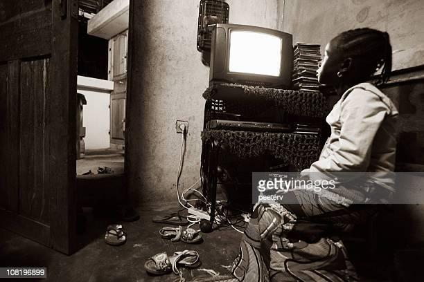 african girl watching tv