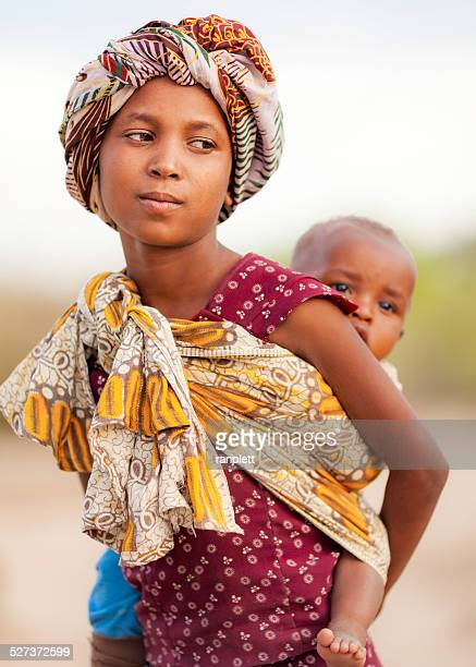 african girl with a baby sling - baby girls stock photos and pictures