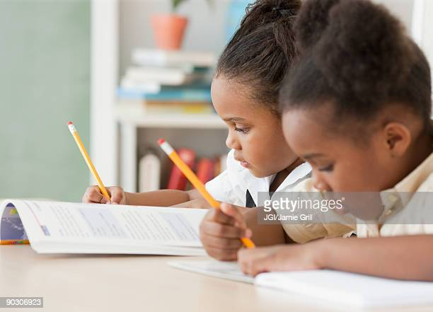african girls doing homework - spelling stock pictures, royalty-free photos & images
