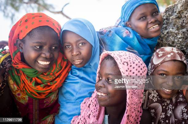 african girls group portrait - africa stockfoto's en -beelden