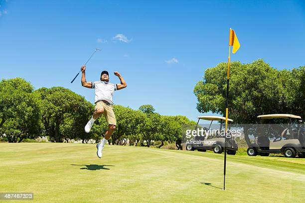 african golfer celebrating sinking his putt! - golfer stock pictures, royalty-free photos & images