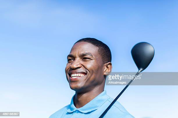 african golfer smiling with confidence, ready to play. - golfer stock pictures, royalty-free photos & images