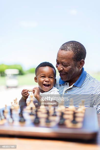 African grandfather having a good laugh with his grandchild
