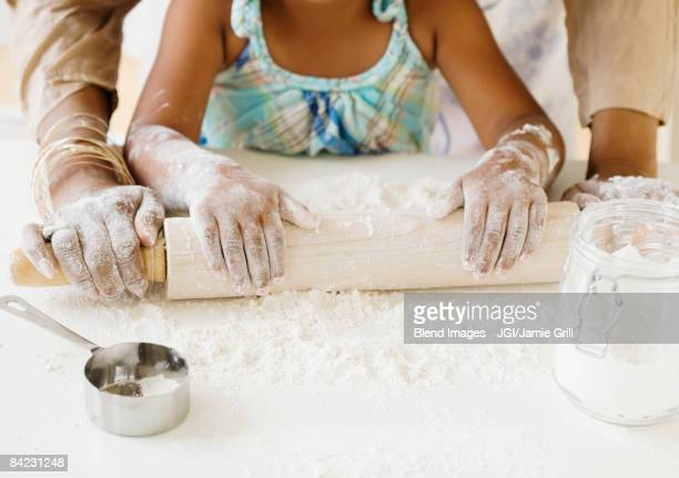 african grandmother baking with granddaughter - 焼いた ストックフォトと画像