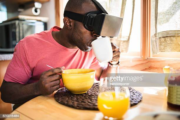 african guy entartains his self with virtual reality device simulator