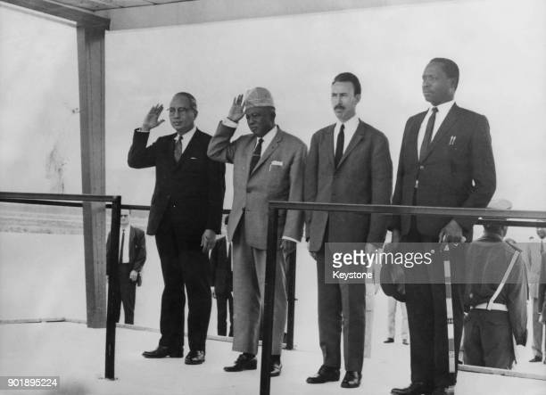African heads of state salute a guard of honour of the Algerian Army at the airport in Algiers Algeria where they have met to discuss the situation...