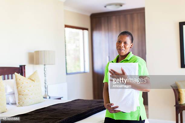 African housekeeper looking at the camera with joy