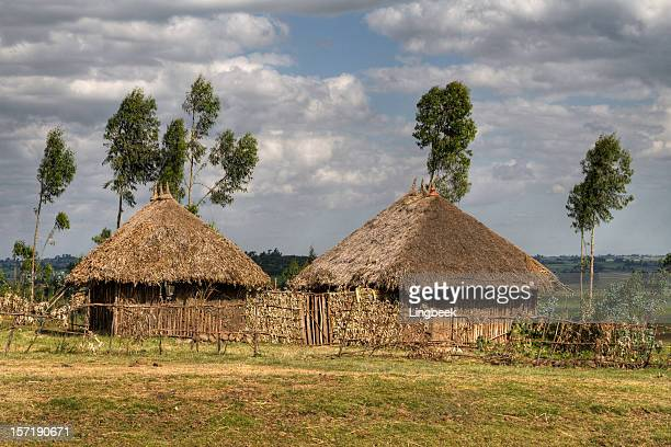 african huts - loam stock photos and pictures