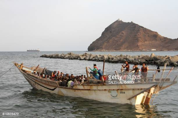 African illegal immigrants sit on a boat in the southern port city of Aden on September 26 before being deported to Somalia Yemeni authorities...