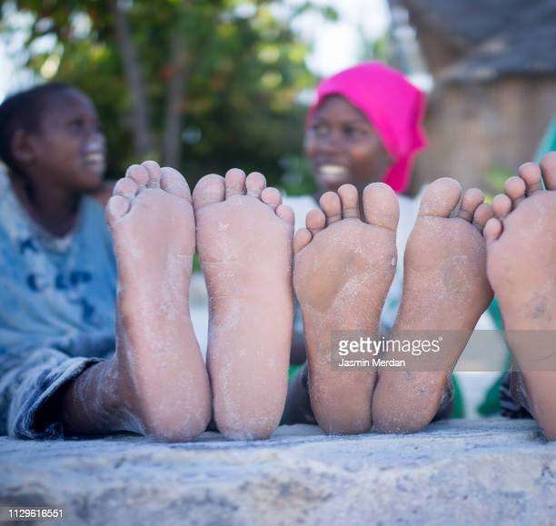 african kids together - hijab feet stock photos and pictures
