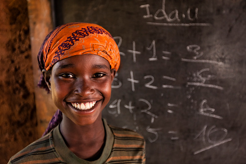 African little girl during math class, southern Ethiopia, East Africa 1147396092