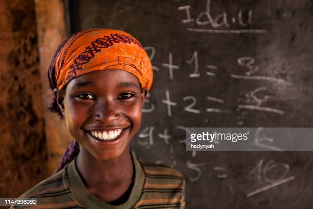 african little girl during math class, southern ethiopia, east africa - poor africans stock pictures, royalty-free photos & images