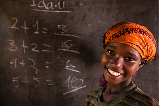 African little girl during math class, southern Ethiopia, East Africa 622035110