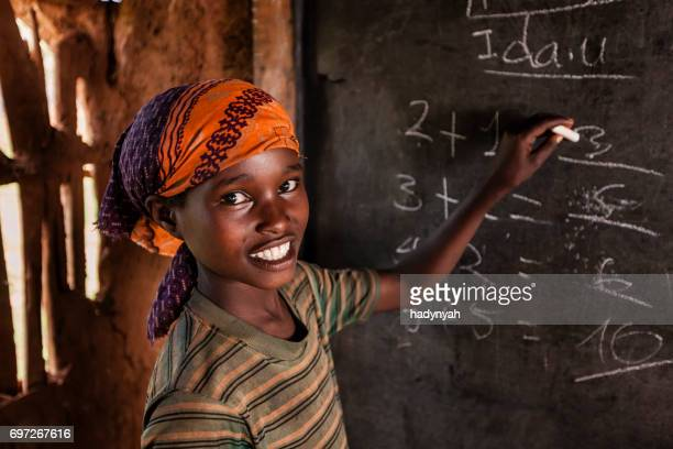 African little girl during math class, southern Ethiopia, East Africa