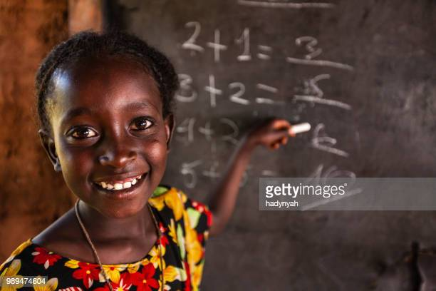 african little girl during math class, southern ethiopia, east africa - africa stock pictures, royalty-free photos & images