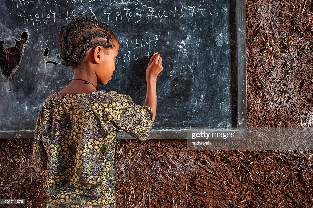 African little girl is learning Amharic language : Stock Photo