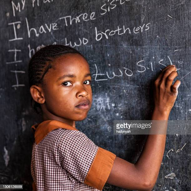 african little girl is learning english language, orphanage in kenya - kenya stock pictures, royalty-free photos & images