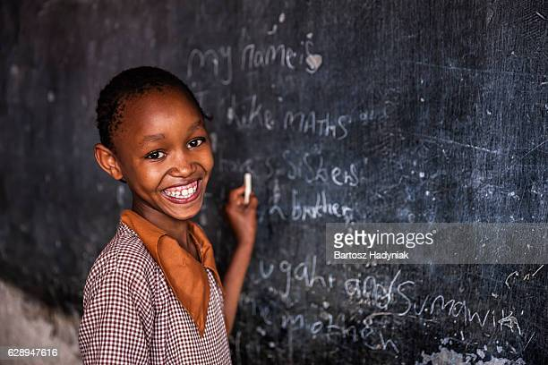 african little girl is learning english language, orphanage in kenya - africa stock pictures, royalty-free photos & images