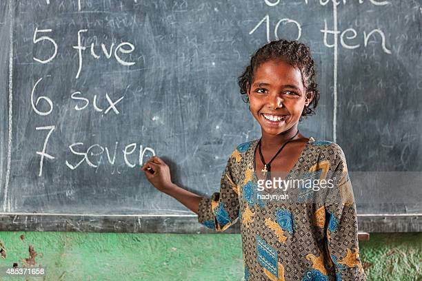 african little girl is learning english language - english culture stock pictures, royalty-free photos & images