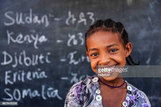 african little girl is learning  english language - poverty stock pictures, royalty-free photos & images
