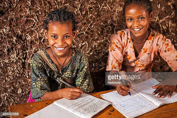 African little girls are learning Amharic language