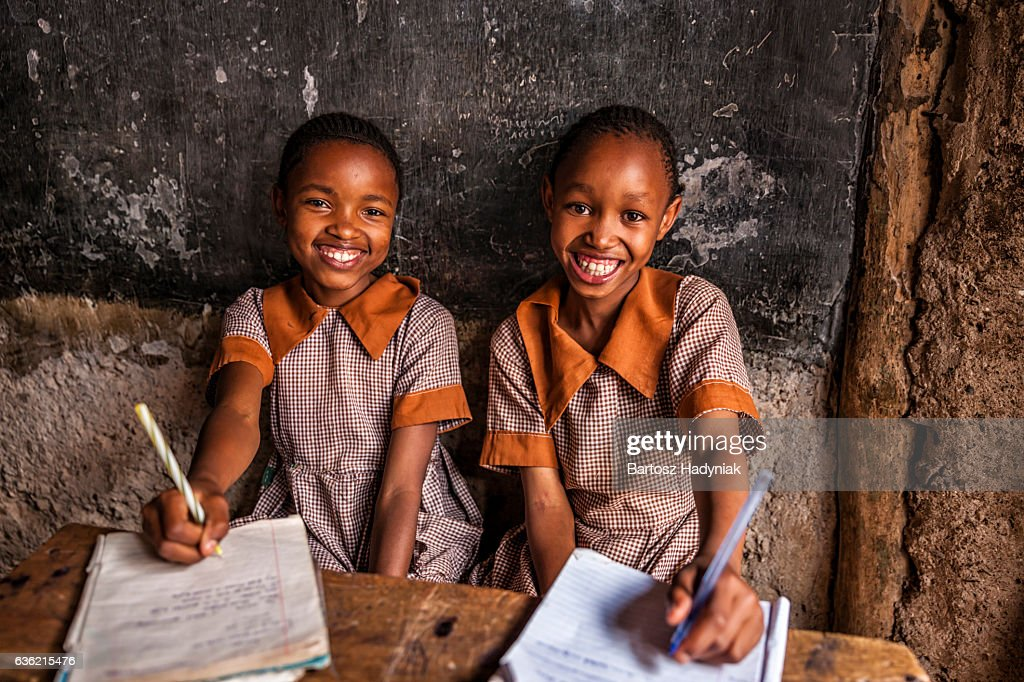 African little girls are learning English language, orphanage in Kenya : Stock Photo