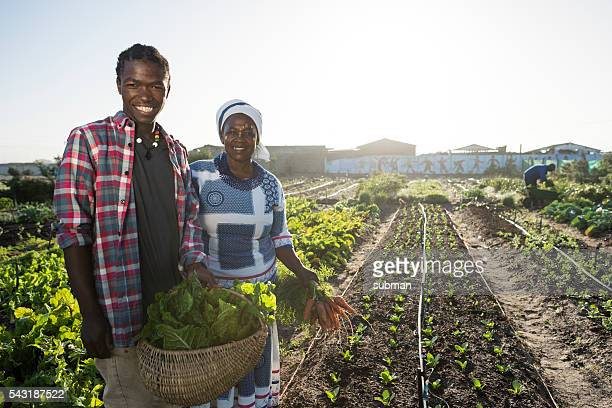 African male and female smiling in garden