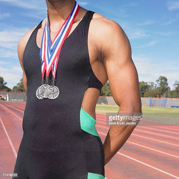 African male athlete with medals