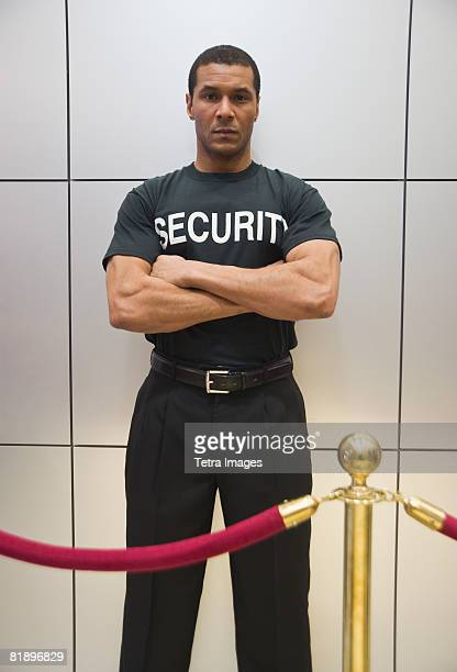 African male bouncer behind velvet rope