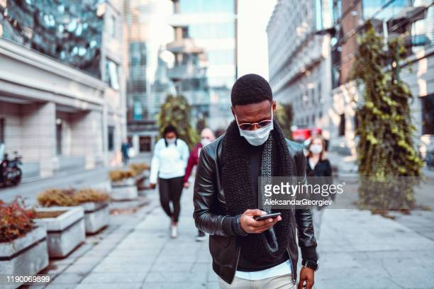 african male demonstrating against air pollution with mask - searching stock pictures, royalty-free photos & images
