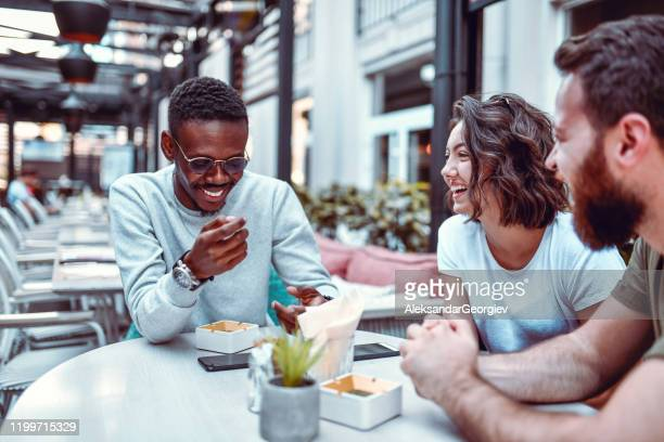 african male enjoying coffee bar mood with caucasian wife and brother in law - brother in law stock pictures, royalty-free photos & images