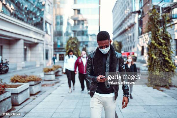 african male leading anti pollution protest in city - protestor mask stock pictures, royalty-free photos & images