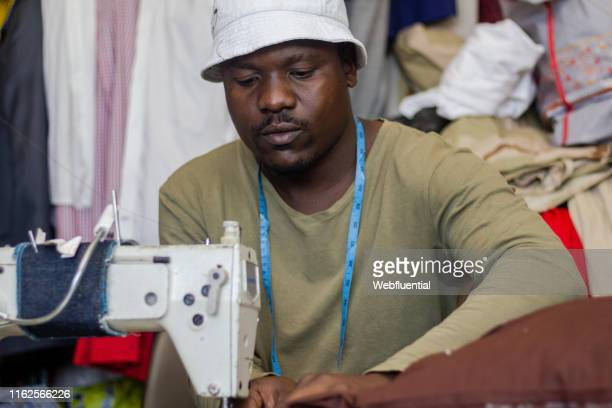 African male tailor with sewing machine