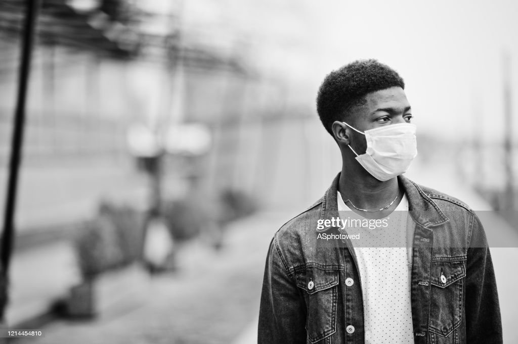 African man at park wearing medical masks protect from infections and diseases coronavirus virus quarantine. : Stock Photo