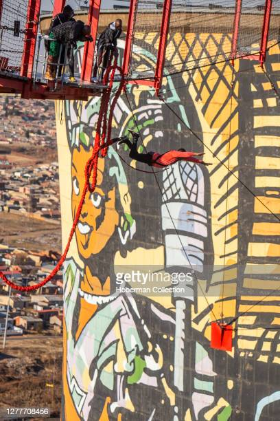 African man bungee Jumping at Soweto Towers, Johannesburg, South Africa