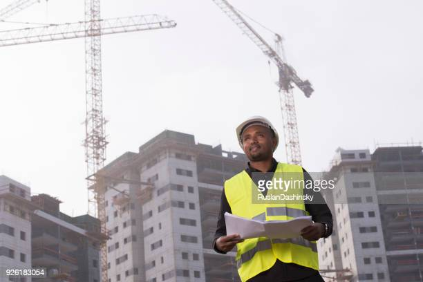 African man civil engineer working at a construction site.
