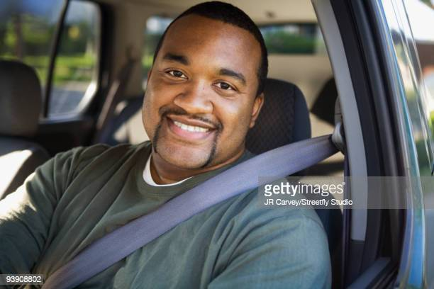 african man driving car - one mid adult man only stock pictures, royalty-free photos & images