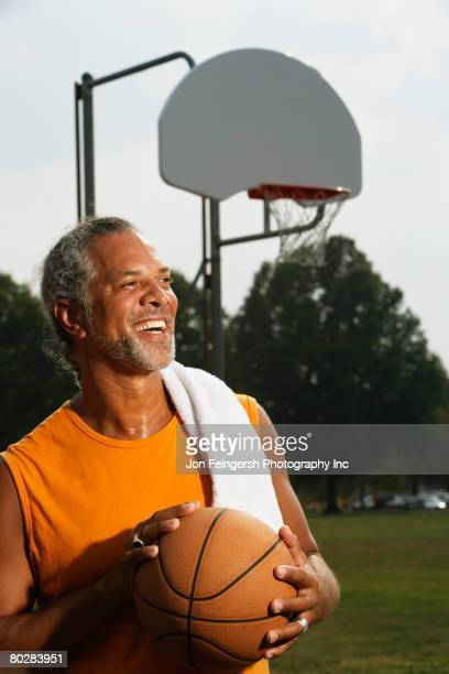 African man holding basketball